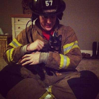 Firefighter with tortoiseshell cat