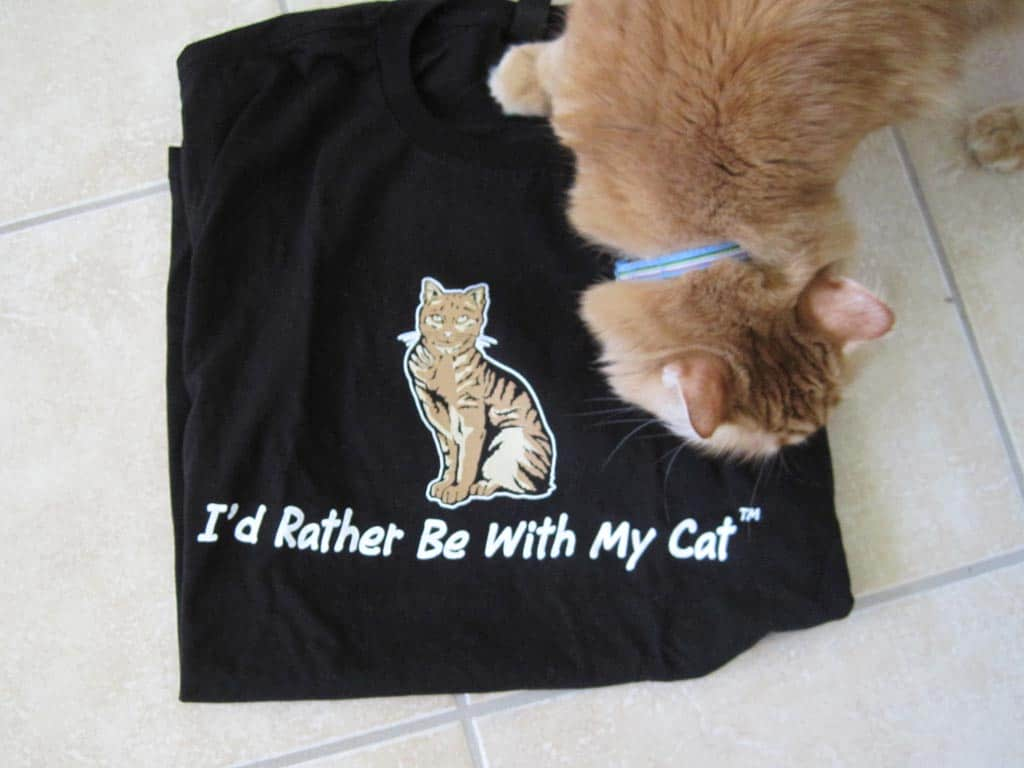Newton inspects I'd Rather Be With My Cat t-shirt