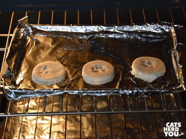 clay paw print keepsakes in oven