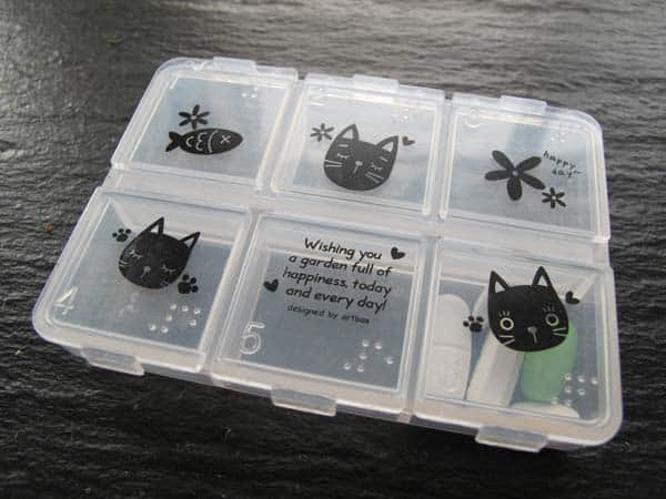 pillbox with cats printed on it