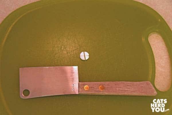 cutting pill on cutting board